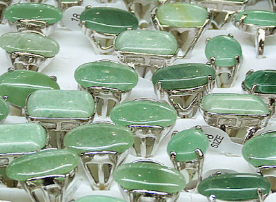 Genuine oval green jade rings in white gold