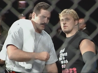 WWE / WWF Summerslam 1998 - Dan Severn gives Owen Hart some encouragement before Hart's Lion's Den match with Ken Shamrock
