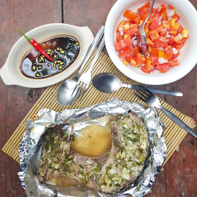 Tuna Jaw wrapped in aluminum foil then baked