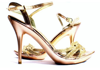 high heeled ladies sandals with lots of embellishment.jpeg