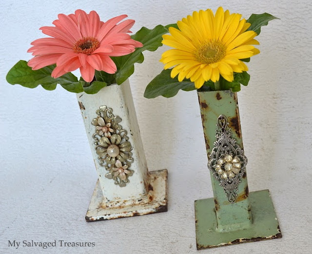 Repurposed industrial bases decorated and used as bud vases
