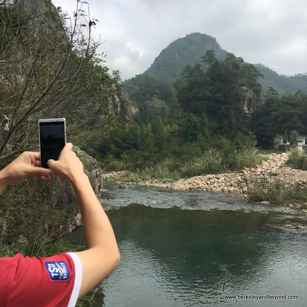 taking photo in Shizhiyan Cliff Scenic Spot in Zhejiang Province, Wenzhou, China