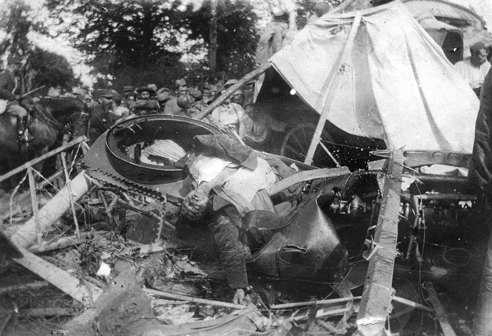 A German pilot lies dead in his crashed airplane in France, in 1918.