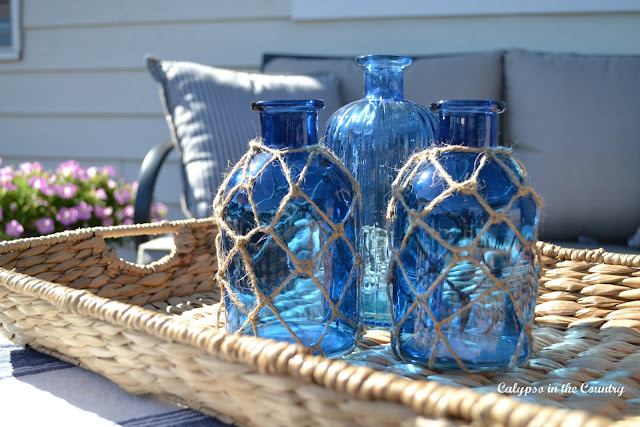 Blue coastal bottles on seagrass tray and other deck decor ideas