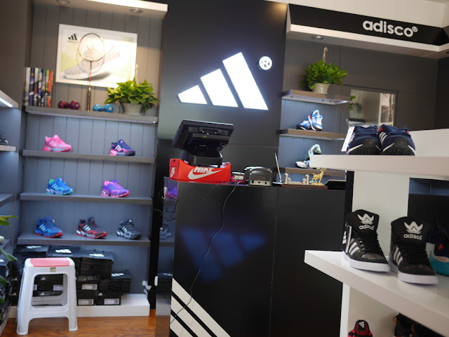 Monitor sitting on top of a Nike shoe box at an Adisco store in Taiyuan