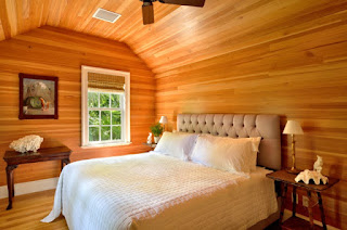 Reclaimed antique heart pine wall paneling and ceiling bedroom