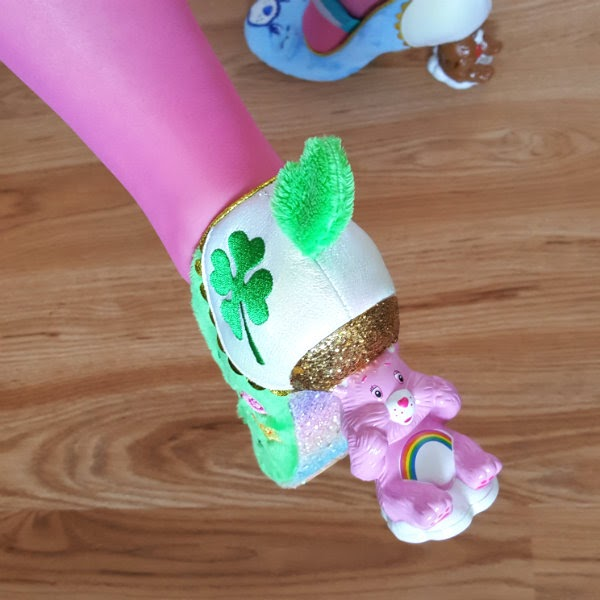 wearing pink tights with pink Cheer Bear heel on green fluffy shoe
