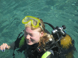 blonde girl scuba diving