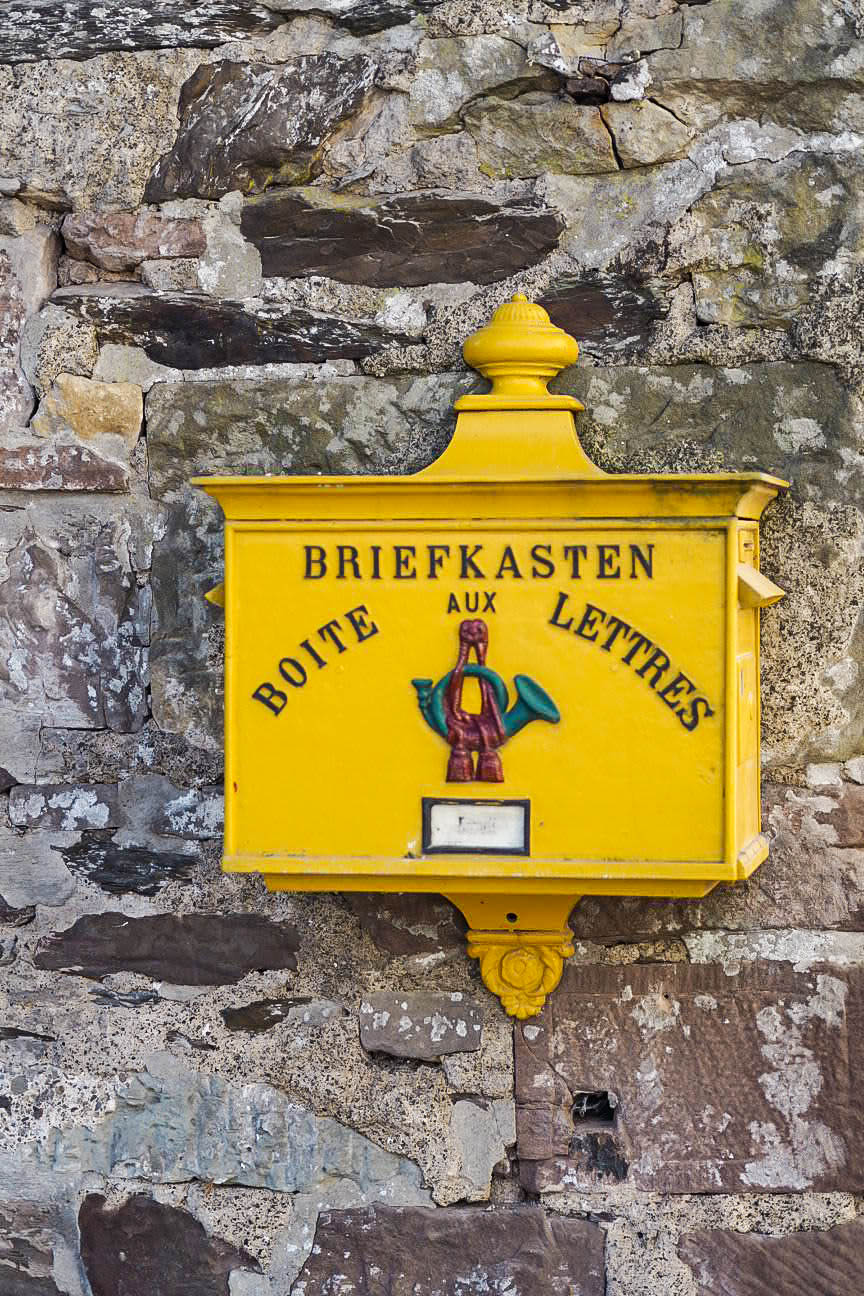 Yellow post box in Luxembourg