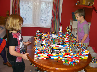 kids making giant lego castle