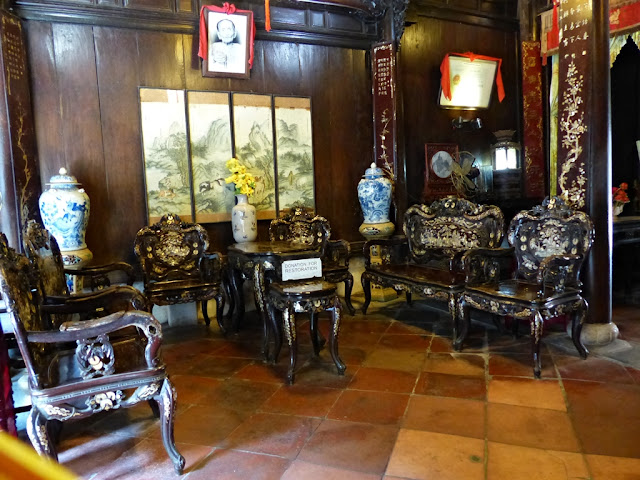 Mother-of-pearl inlaid furniture inside the old house in Hoi An