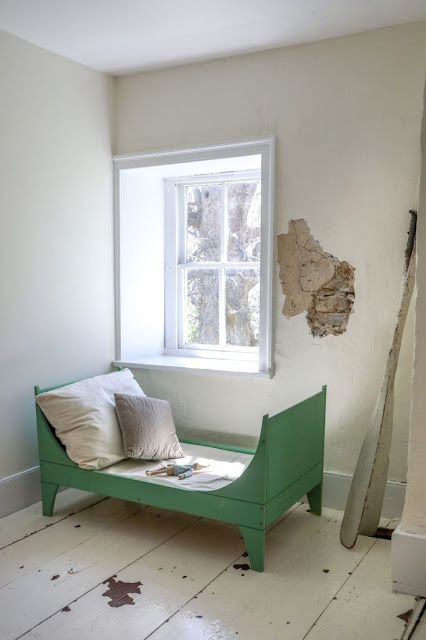 Handmade green toddler bed in rustic farmhouse with white painted floor - found on Hello Lovely Studio