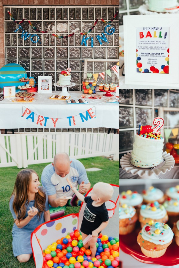 Parents with child in ball pit themed first birthday setting.
