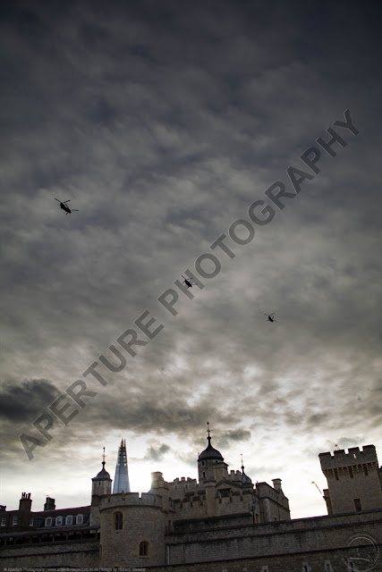 Three Boeing Chinooks flying over the Tower of London