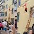 Half-naked woman filmed dangling from cable after lover's wife return home earlier than expected