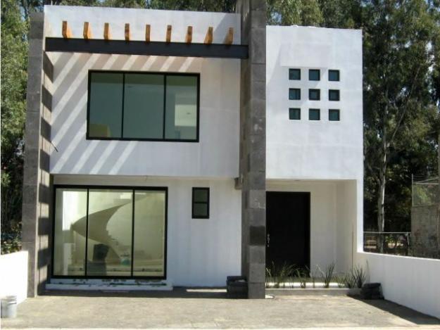 Fachadas minimalistas marzo 2012 for Casa minimalista 2 plantas