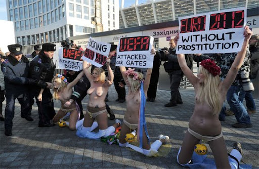 Protesters demonstrate against prostitution during the upcoming Euro 2012