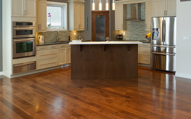Beautiful wood-like resilient flooring provides a contemporary look to this kitchen