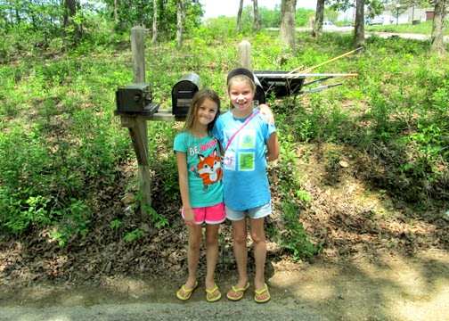 Tessa and her neighbor friend posed for a quick pic before setting to work on their iris bulb garden.