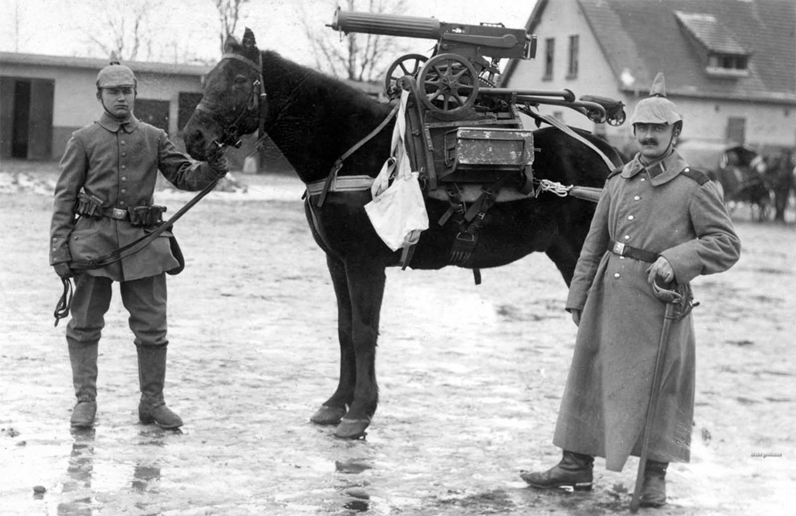German soldiers pose near a horse mounted with a purpose-built frame, used to accommodate a captured Russian Maxim M1910 machine gun complete with its wheeled mount and ammunition box.