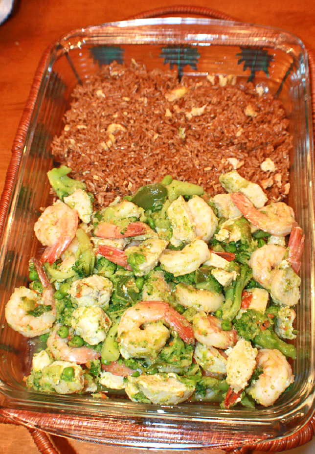this is a plain stir fried rice and then on the other side chicken and shrimp stir fried in the same oven proof glass baking dish