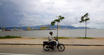 Pulau Pinang from the land-side view is to the west