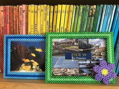 Hama bead photo frames on book shelf