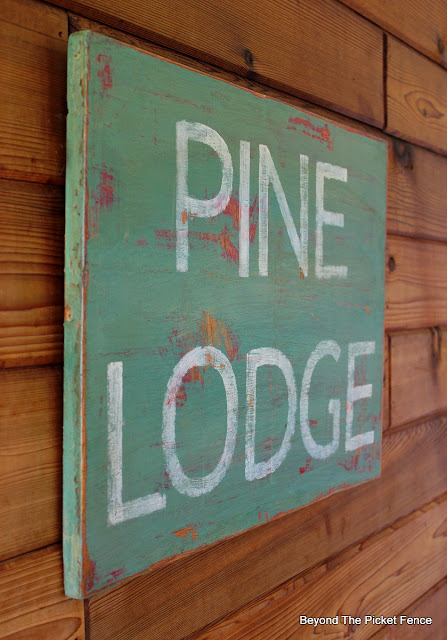 rustic pine lodge chippy sign