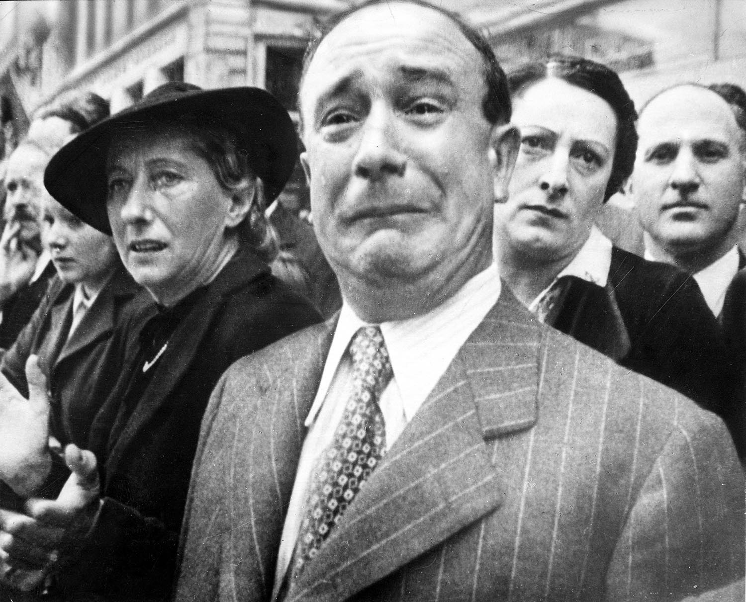 French people staring and waving at the French Army remaining troops leaving metropolitan France at Marseilles harbor, 1940.