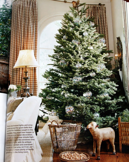 Pamela Pierce designed living room decorated with antiques for Christmas. #frenchcountrychristmas