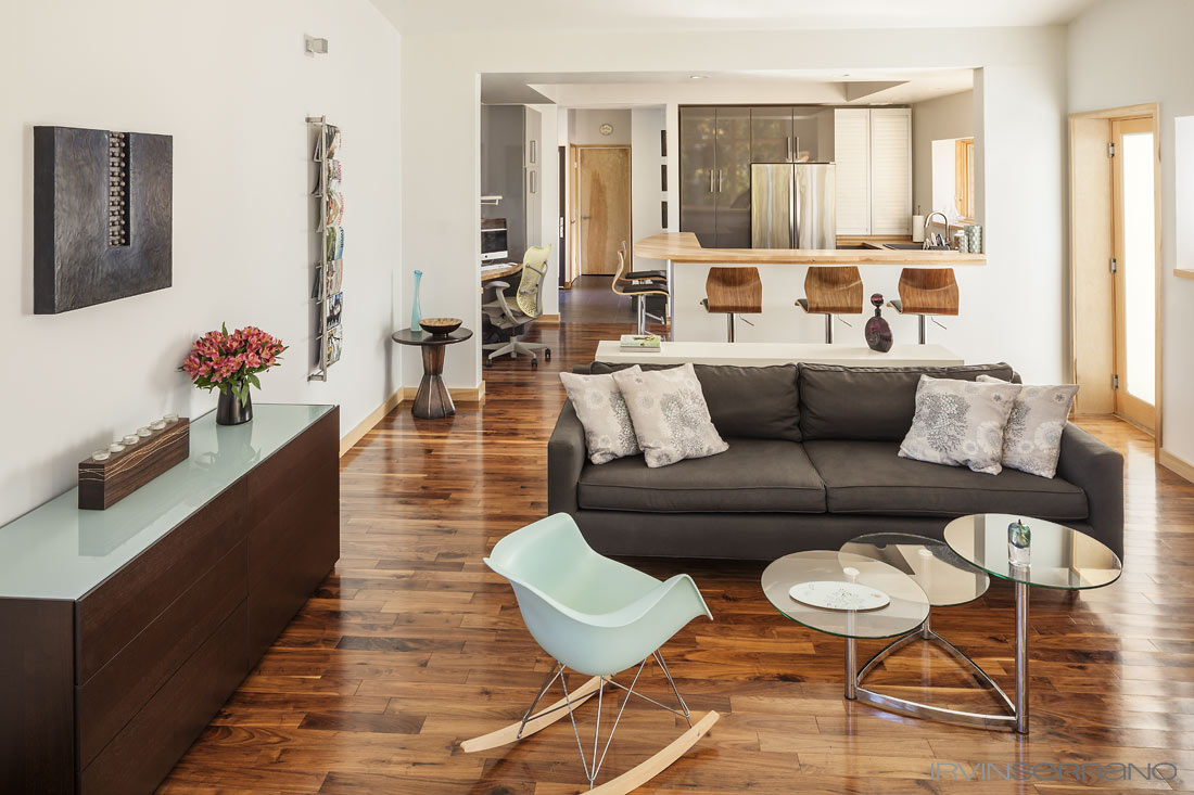 Clean lines, wood floors, contemporary furniture and an open concept layout enhance the feel of modernity in the home built by Darren Commerford