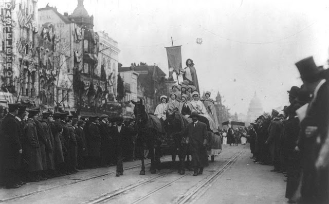 Spectators crowd in on the passing Suffrage Parade on Pennsylvania Avenue, on March 3, 1913.