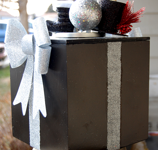 black santa boots, silver bulb, black snowman hat, and silver glitter bow