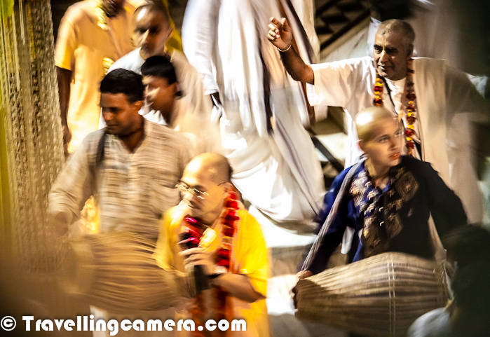 Recently we visited Vrindavan and also visited to some of the popular temples out of 5000+ temples in Vrindavan. Iskcon Temple was the first we explored inside the Vridavan Market. It was time for evening pooja inside the Iskcon Temple and Photo Journey is trying to share some of the interesting moments...Above two photographs show people enjoying amazing music inside the main Temple of Lord Krishna. This music fun at Iskcon temple is unmatchable and one feels like dancing there for long hours. Lot of folks keep joining the group to sing 'Hare Krishna.. Hare krishna..' in different tones and various choruses. Different groups of families, ladies and boys join in for dance. A wonderful experience to be there inside Iskcon Temple during evening Aarti.Here is a part of Iskcon Temple Vridavan, which is dedicated to founder of Iskcon Temples - Srila Prabhupada ! In 1965 at the age of 69, Srila Prabhupada traveled by ship to America and, once there, began teaching people about the Vaishnava tradition. Between 1966 and 1968 temples were established in several American cities. The first Ratha-yatra, a traditional festival that Srila Prabhupada had copied as a child, was held in 1967 in San Francisco.To know more about Prabhupada, please check out - http://www.radhadesh.com/en/about-us/who-we-are/srila-prabhupada-founder-of-iskconHere is first view of Iskcon Temple at Vridavan, which we see after entering into the Temple campus from Market. It's a huge temple made up of white marble stones. As you can notice, most of the parts of this temple are decorated with flowers and everyday these flowers are changed. Some of the temples are multistory and folks can have view of main temple area from ground floor as well as galleries on second floor.Here is a photograph showing some fireworks in the background of the Iskcon Temple at vrindavan, Uttar Pradesh, India. We are not sure if this is something related to evening pooja inside the temple or India had won some cricket match :) ..
