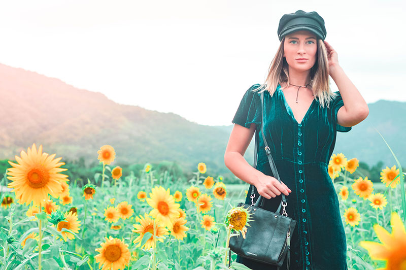 sunflower fields fashion shoot teal velvet dress baker boy hat summer outfit