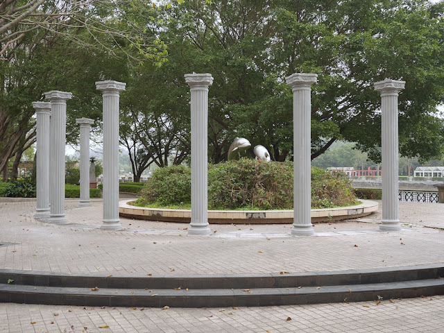 sculpture of dolphins bordered by classical columns in Jiangmen