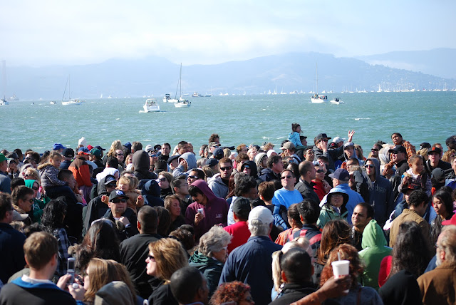 the crowd on land and sea