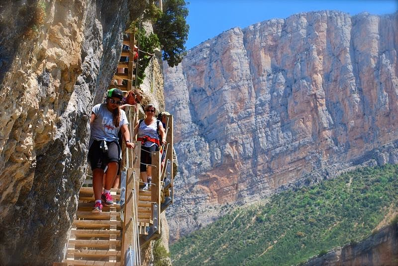 The Frightful pathway between Catalonia and Aragon, Spain, the River Noguera Ribagorçana passes through the Serra del Montsec mountain system, creating a beautiful hiking destination called Congost de Mont-Rebei.
