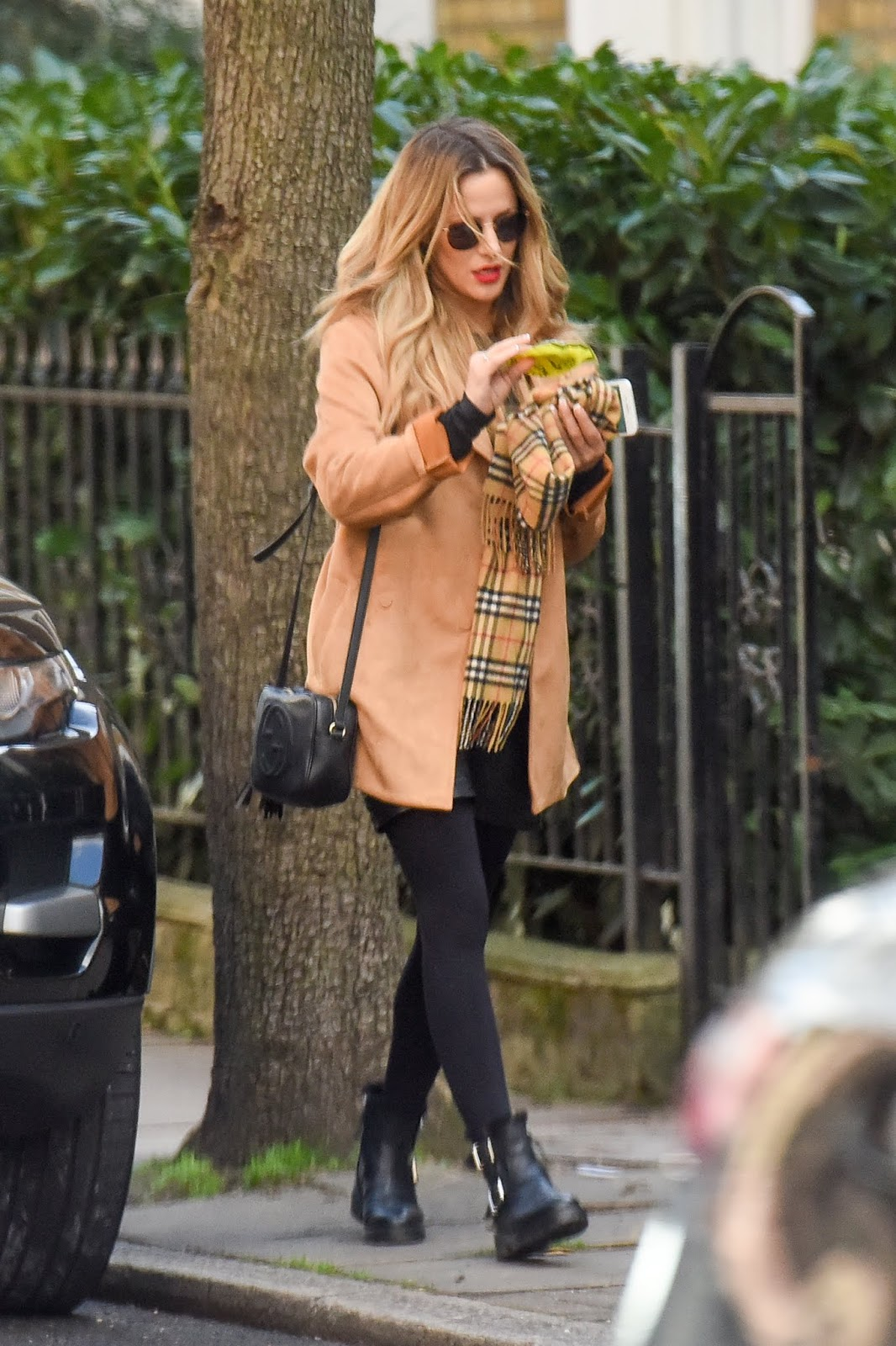 Caroline Flack gets a parking ticket on her Range Rover while out and about running errands in London  - 02/19/2019