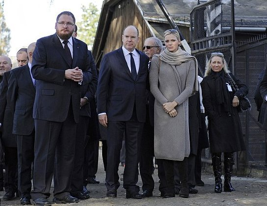Prince Albert and Princess Charlene have visited the memorial of the former Nazi German death camp of Auschwitz-Birkenau and laid flowers at its Execution Wall
