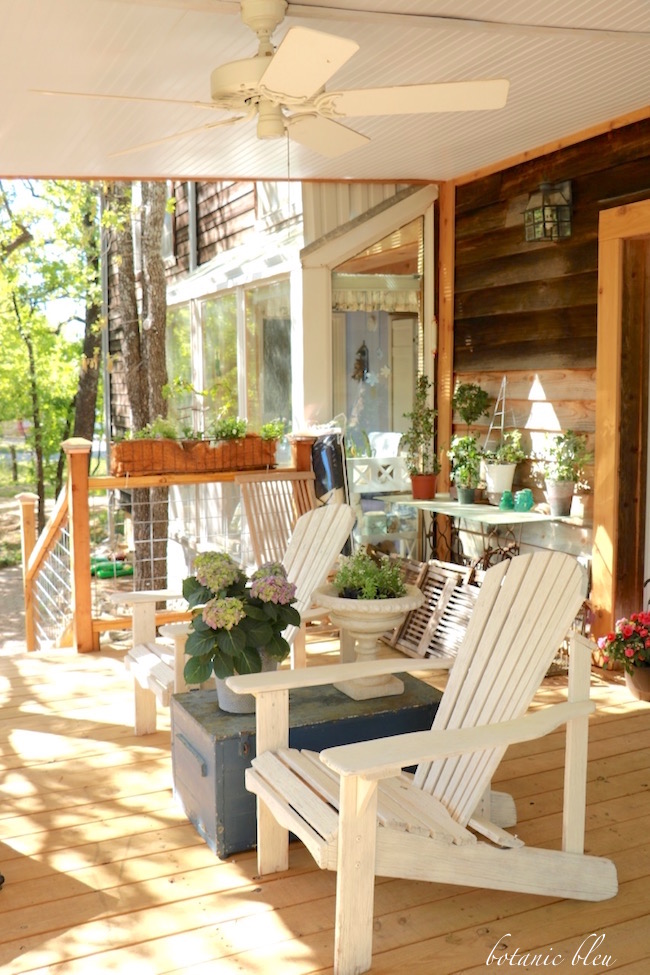 white-adirondack-chairs-on-covered-porch