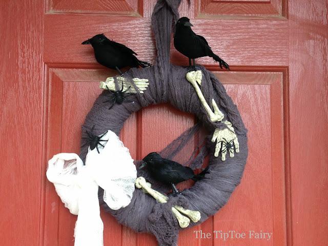 Creepy Crows and Bones Halloween Wreath | The TipToe Fairy #halloweendecorations #halloween #wreathtutorial #halloweentutorial