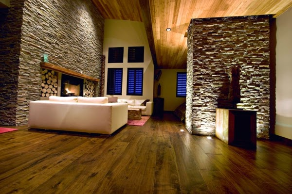 Minimalist Living Room Design With Creative Lighting Of Natural Stone Walls