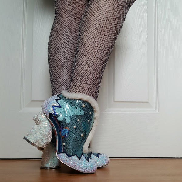 wearing polar bear heeled booties with transparent upper and sea animals applique