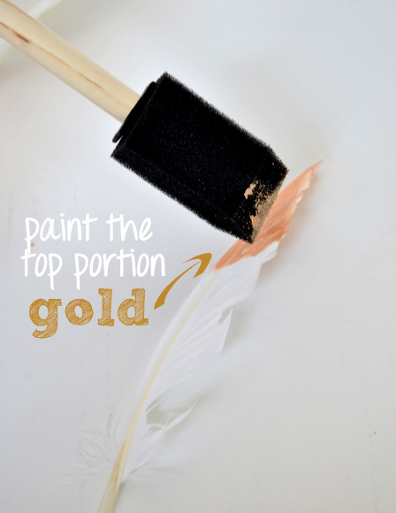 Paint the top tip of the feathers with the gold metallic paint