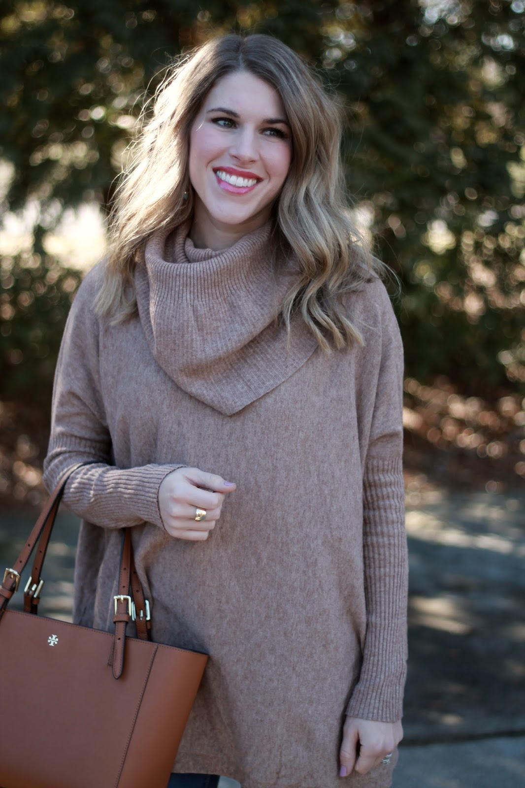 camel oversized turtleneck tunic sweater, Old Navy Rockstar soft jeans, brown suede riding boots, Tory Burch cognac tote