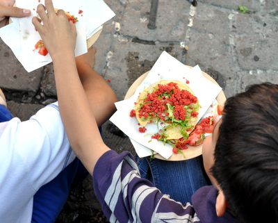 Boys sharing tortillas in Oaxaca, Mexico.