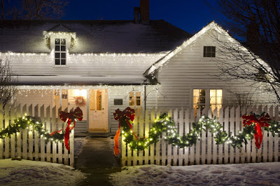 Incorporating natural lighting via wreaths and pre-lit garland is an easy way to class up your Christmas lighting display.