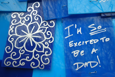 "Write printing on a blue background. ""I'm so excited to be a dad!"""
