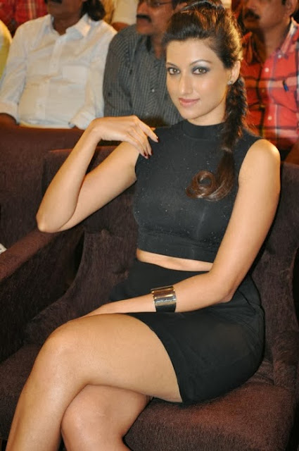 Hamsa Nandini crossed leg pictures in Black Short Skirt with Silver Pumps